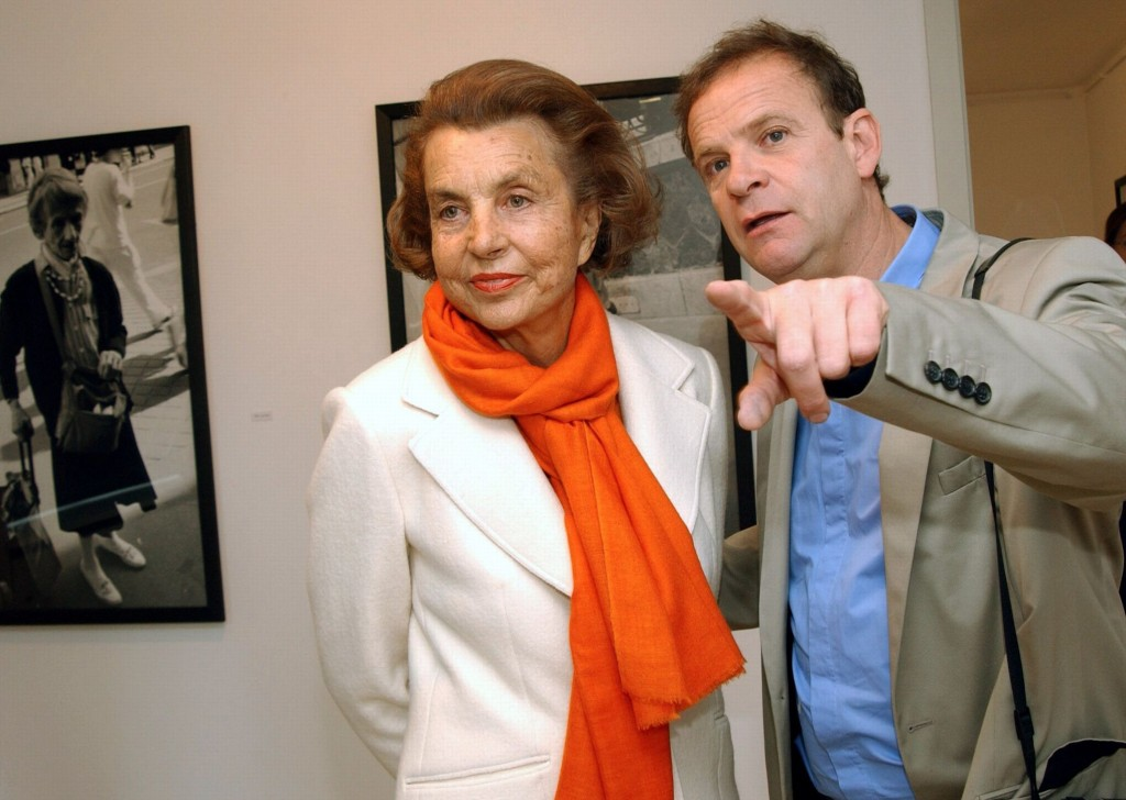 (dpa file) - French photographer and author Francois-Marie Banier (R) presents his exhibition to L'Oreal matriarch Liliane Bettencourt at the Museum ?Hans Lange? in Krefeld, Germany, 13 June 2004. The billionaire and L?Oreal heiress is in conflict with her only daughter - and an end is not in sight. Francoise Bettencourt- Meyers accuses her 86 year-old mother of throwing around with money due to mental incapacity. She is said to have given Francois-Marie Banier presents worth some one billion Euro. Mrs Bettencourt-Meyers has reported to the state attorney?s office. Photo: Horst Ossinger
